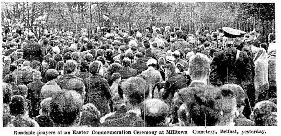 Crowd kneeling in the rain outside Milltown cemetery, Easter Commemoration 1935